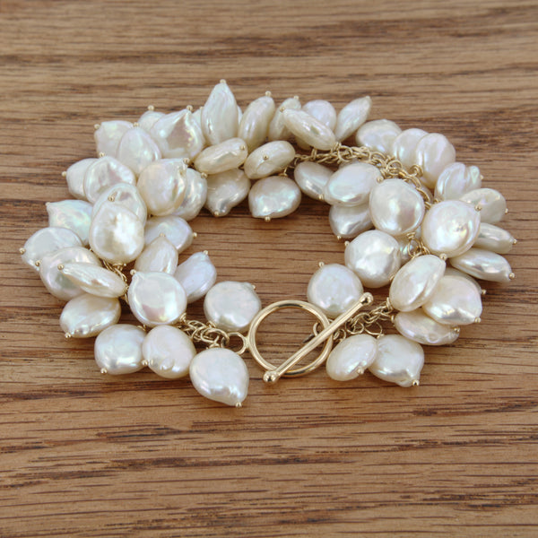 14k yellow gold toggle jaggy bracelet baroque coin shape fresh water pearls beautiful creamy-white irridescence/lustre easy to use toggle clasp