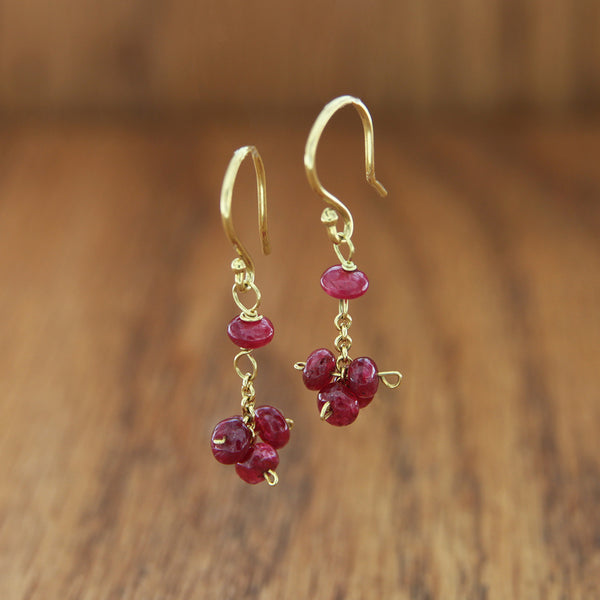 18k yellow gold dangle earrings with ruby rondel clusters
