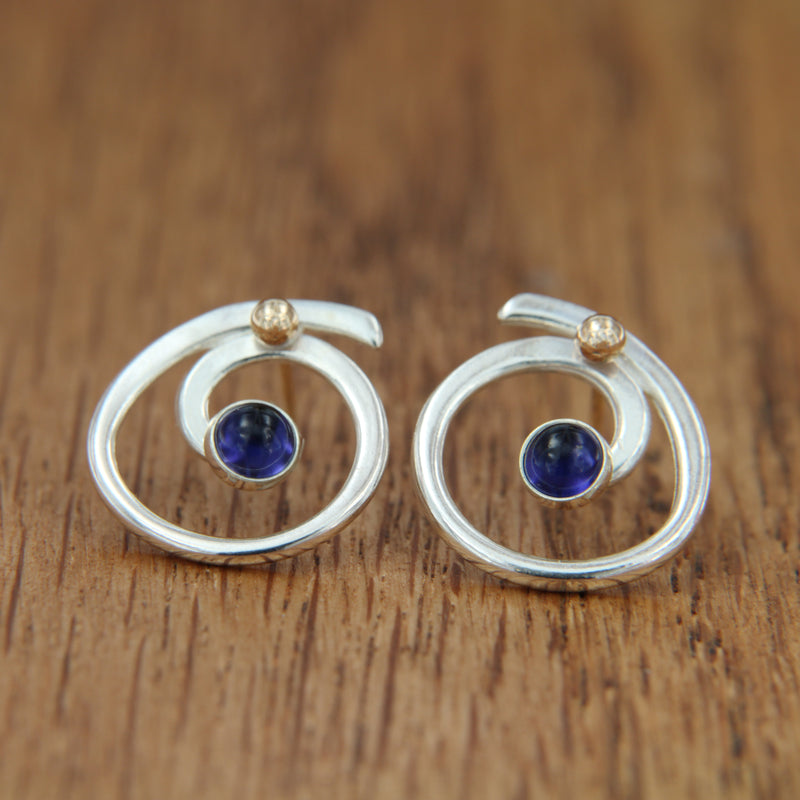 women's sterling silver iolite post earrings with yellow gold swirl design