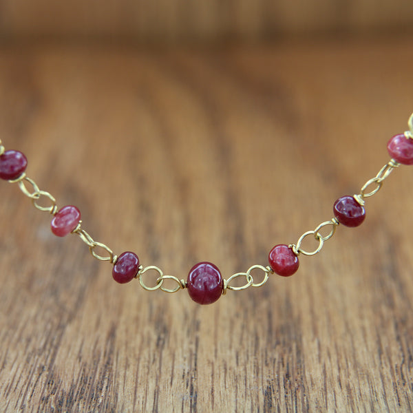 18k yellow gold necklace with ruby rondel