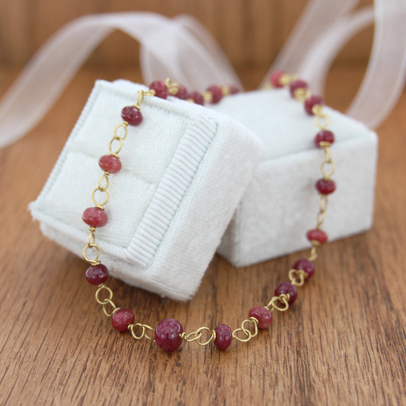 18k yellow gold necklace with ruby rondel with box