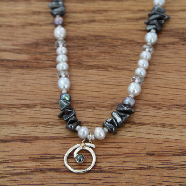 sterling silver spiral w/hematite cabochon & 14kY ball accent on freshwater pear, hematite & swarovski crystal beaded necklace
