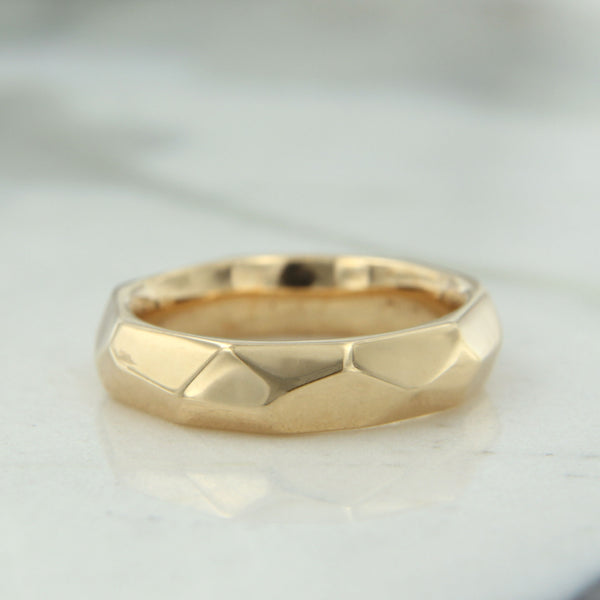 14k yellow gold faceted wedding band side one
