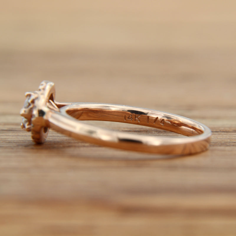 side view of beautiful engagement ring rose gold round diamond center with halo