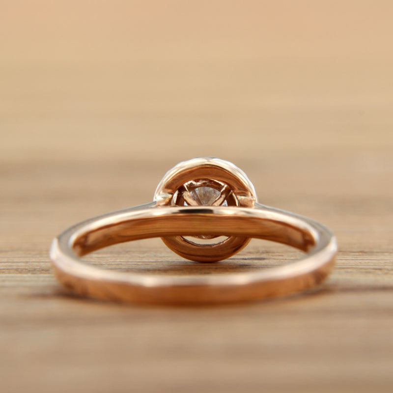 round diamond center with halo rose gold engagement ring