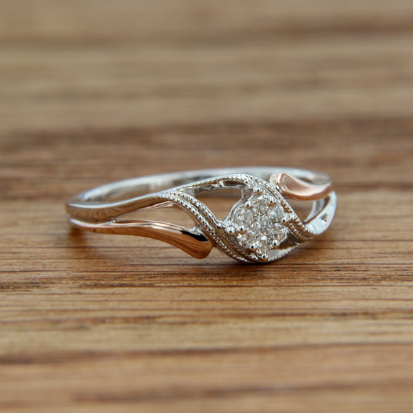 10K white and rose gold ring .10 CTTW 7 round diamonds millgrain detail