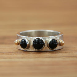 Sterling silver hammered ring w/3 bezel set onyx cabachons and two 14KY gold ball accents