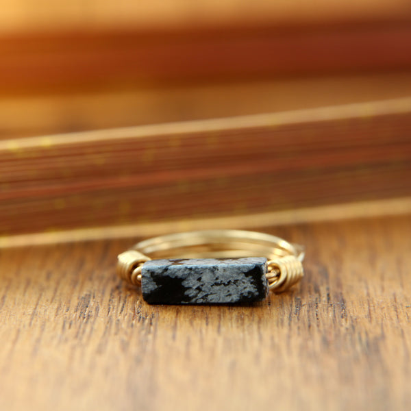unique yellow gold ring with snowflake obsidian