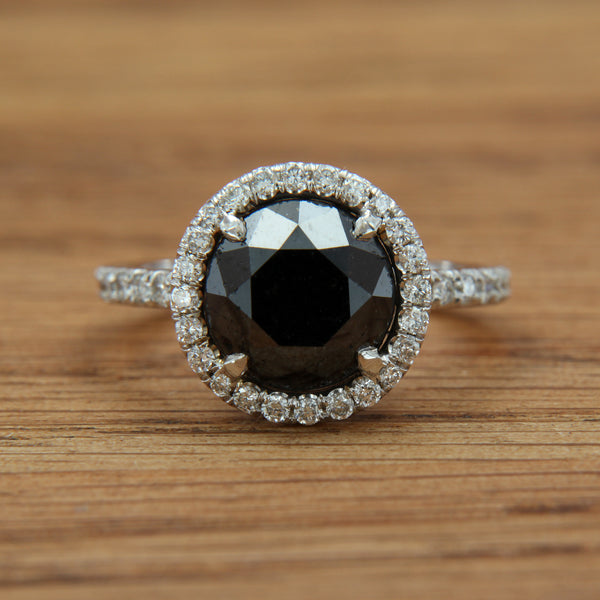 black diamond white gold ring with white diamond halo