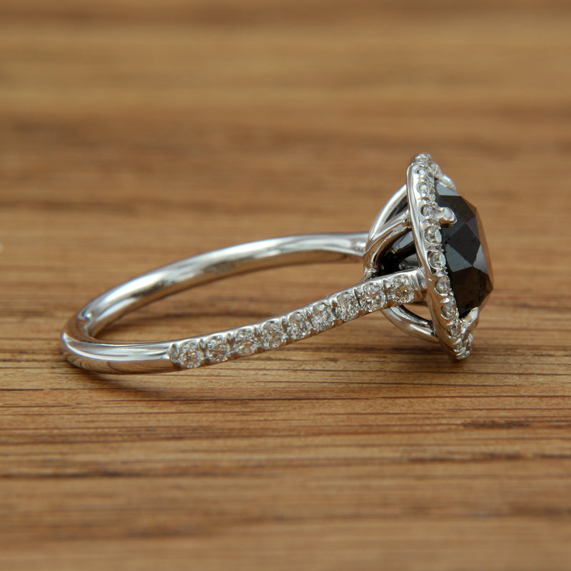 black diamond white gold ring with white diamond halo side view