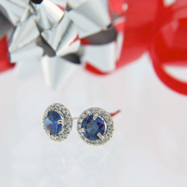 round blue sapphire with diamond halo post earrings 18 karat white gold
