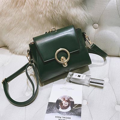 Image of Guislaine Round Metal Lock Handbag