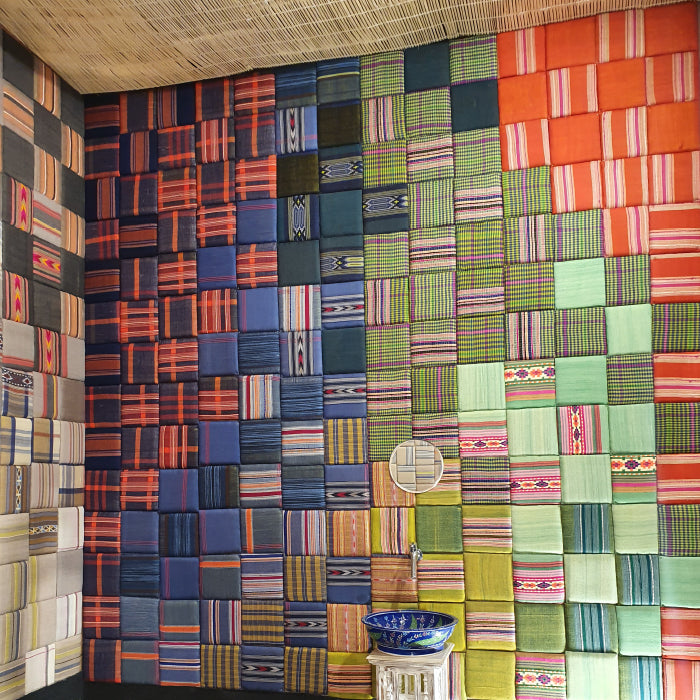 Fabric wall-paneling by Sihasn done using Kullu shawls woven by tribal women in Himachal Pradesh