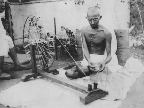 Gandhi Spinning Khadi Cotton at his Chakra