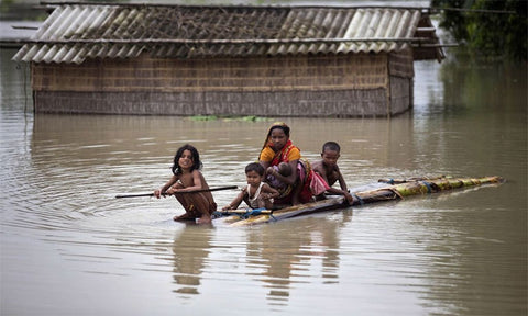 Villagers on a raft during a flood