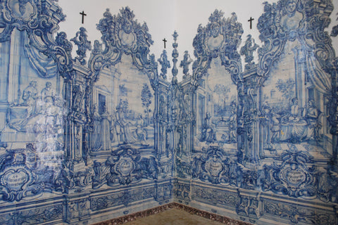 The wall of a church in Portugal covered in Azulejo tiles