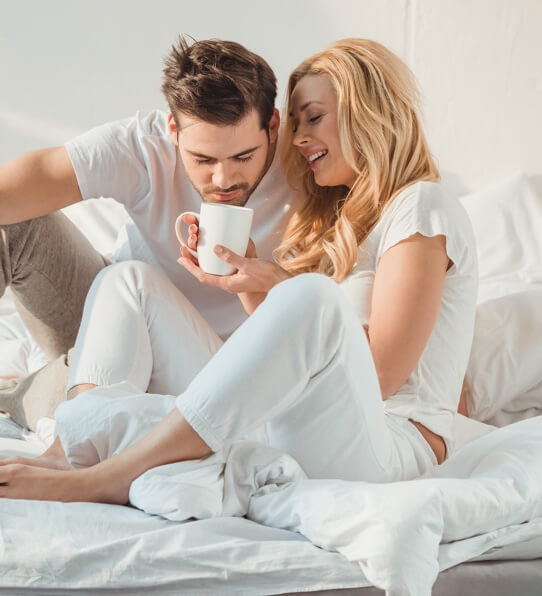 couple looking at tea cup