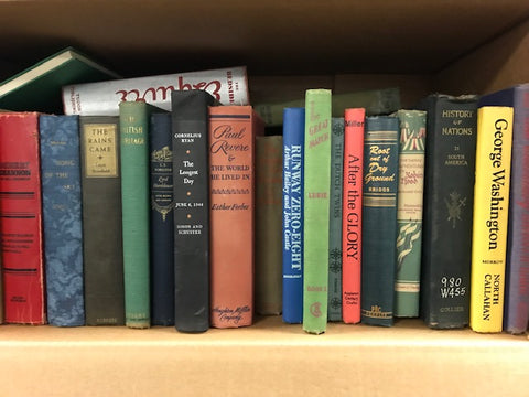 vintage books by the foot and color sold by the book bundler