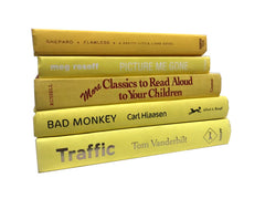 Decorative modern yellow books by the foot and color sold by the book bundler
