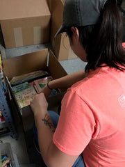 female employee, children's books, warehouse work