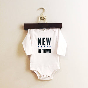 NEW IN TOWN screen-printed baby bodysuit