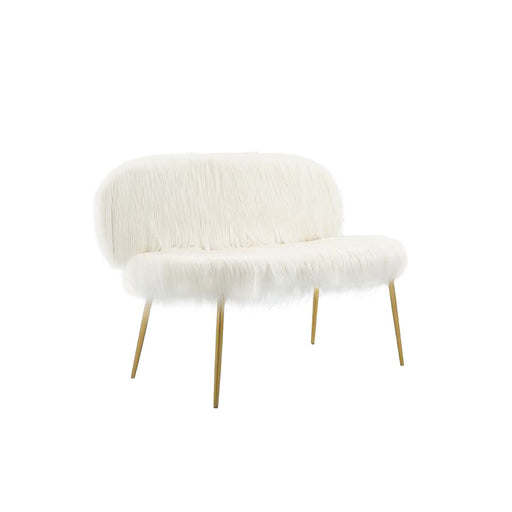 Sofa draped with fauz fur with gold legs