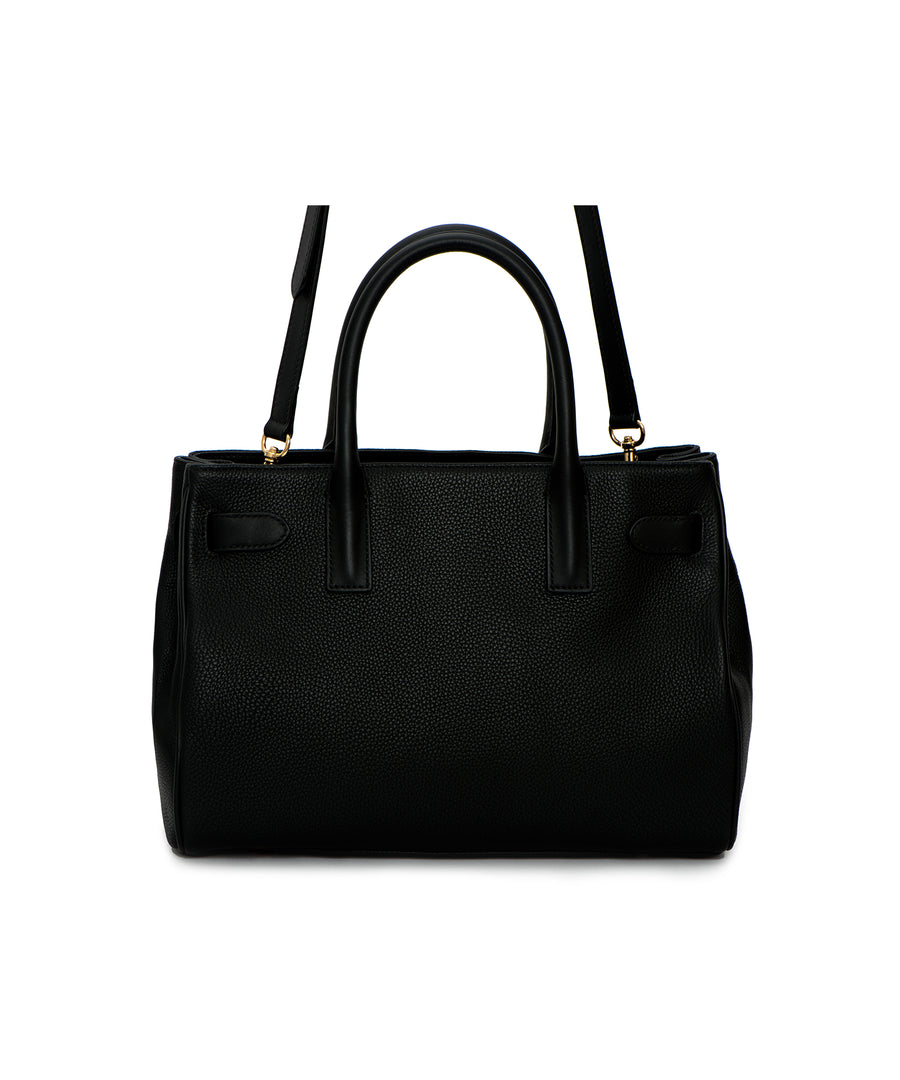 The Magnolia: A designer, black shoulder bag and satchel featuring pebbled leather and functional detail