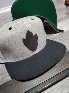 Snap Back Midnight Leather logo
