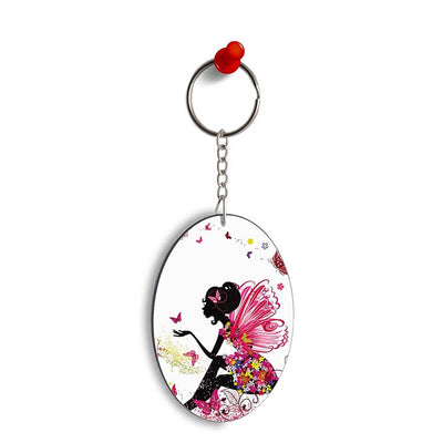 The Pixie With Her Butterflies Oval Key Chain