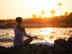 Girl Meditating In The Sunset