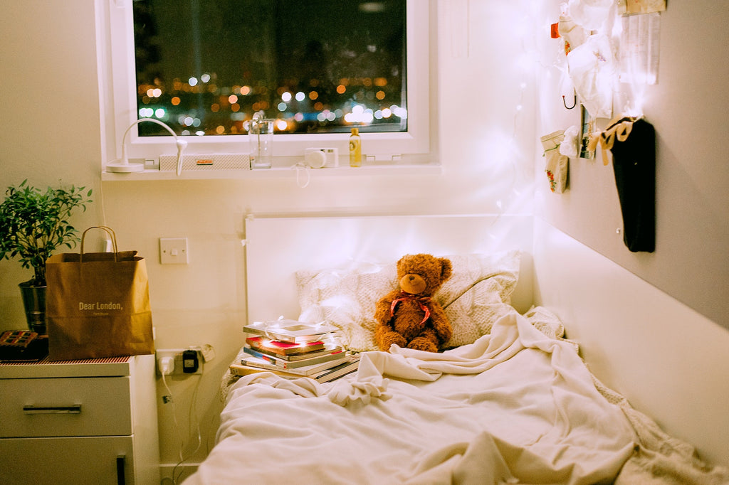 Cute, comfortable dorm bed twin XL with teddy bear.
