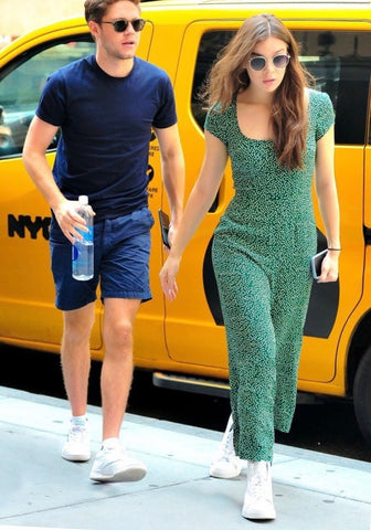 Hailee Steinfeld wearing a green jumpsuit out with boyfriend