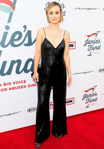Olivia Wilde wearing a wide leg sequin black jumpsuit