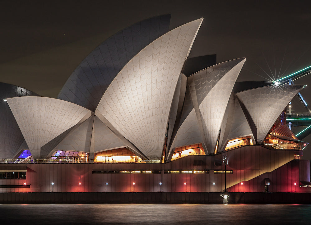 'the iconic Sydney opera house by night' by Bryson Prior