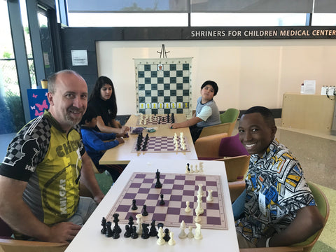 Shelby playing chess at Shriner's Children's Hospital with Sean's Fund Coach Jay