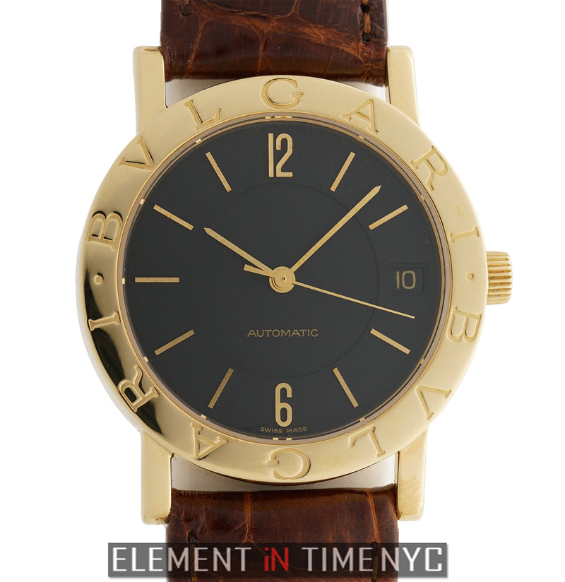 18k Yellow Gold Black Dial 33mm