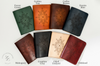 Legacy Leather Books color selection: Forest Green, Golden Tan, Coffee Brown, Denim Blue, Mahogany, Graphite Gray, Oiled Undyed, and Oxblood.