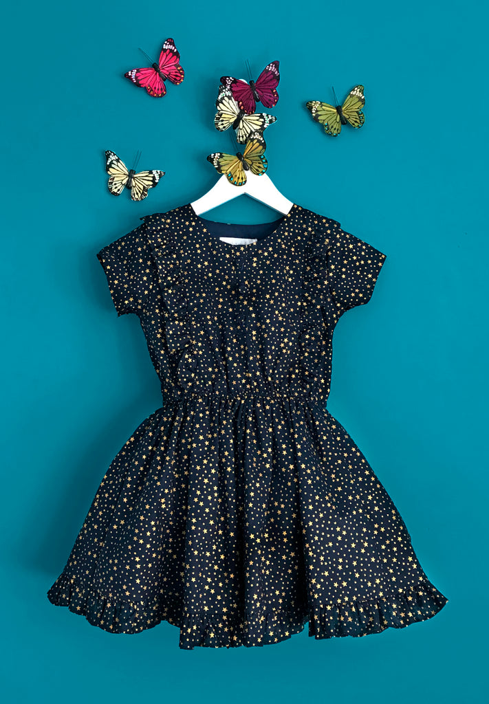 Girls and Childs Autumn Winter gold star print cotton frill dress in midnight blue and gold.