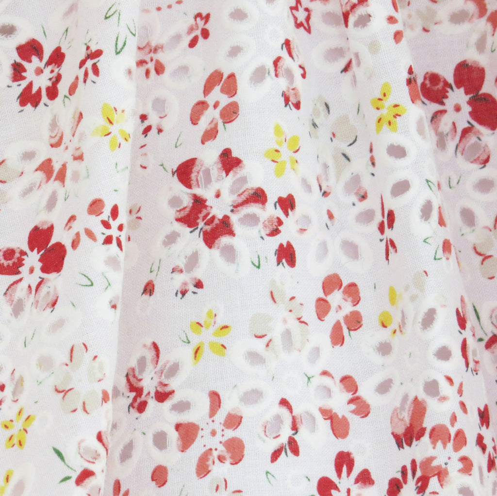 Childs Summer floral print and broderie anglaise dress fabric close up