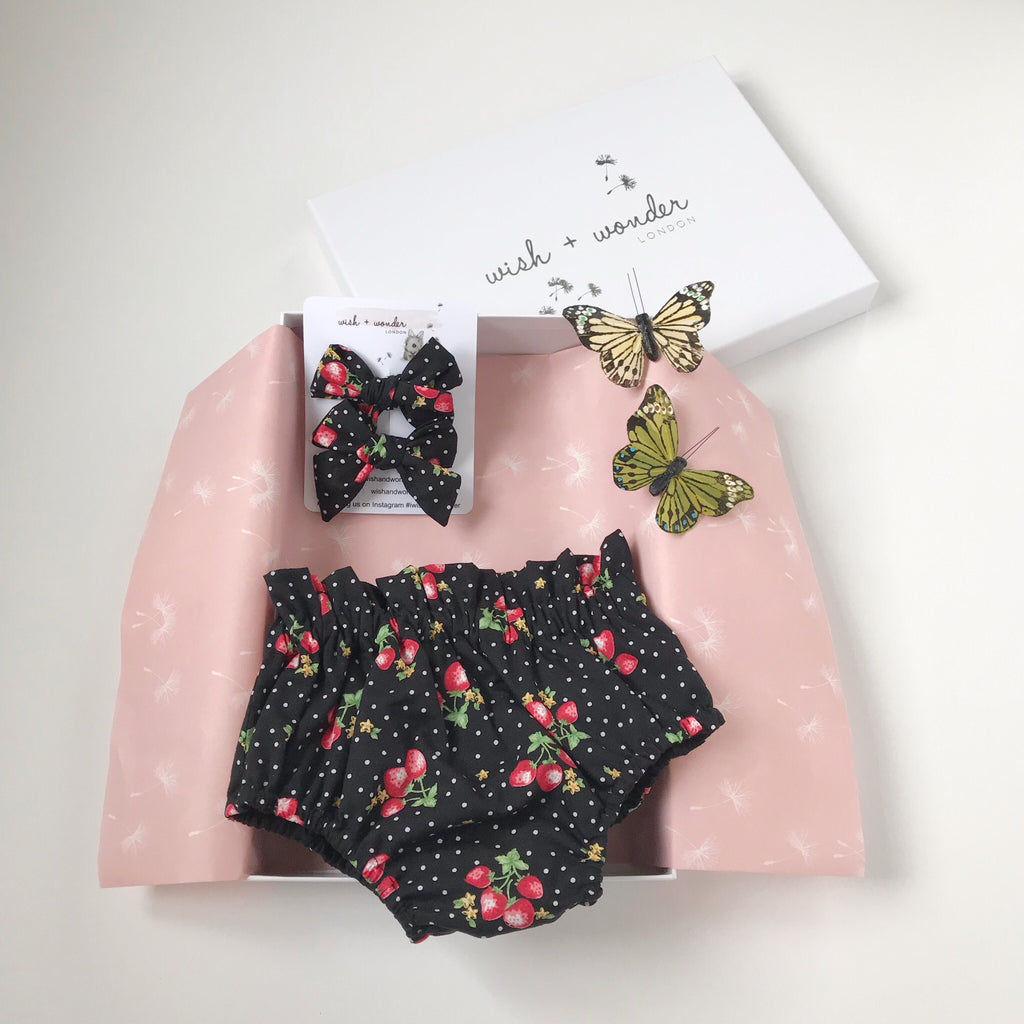 Baby and toddlers highwaisted bloomer shorts with two matching hair bows in strawberry and spot print.