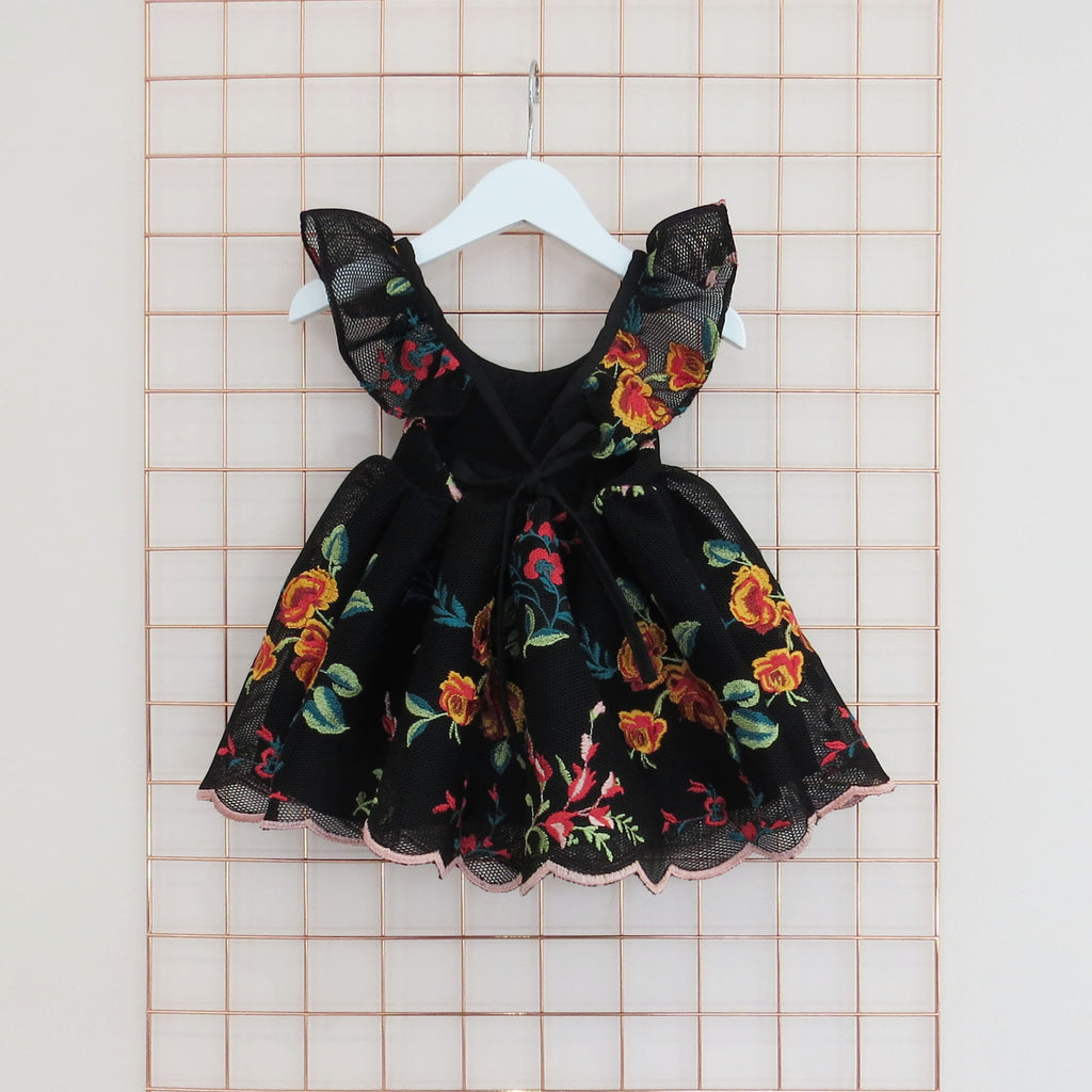 Summer colourful floral embroidery on black spacer mesh with frill sleeves