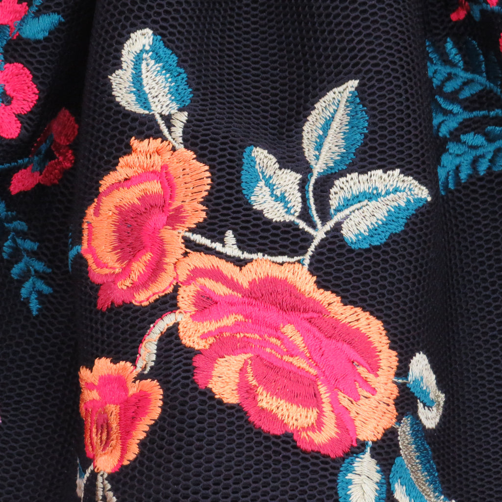 Summer colourful floral embroidery on black spacer mesh close up of fabric