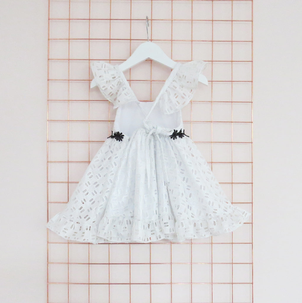 Summer silver foil cotton geometric broderie anglaise dress with frill sleeves.