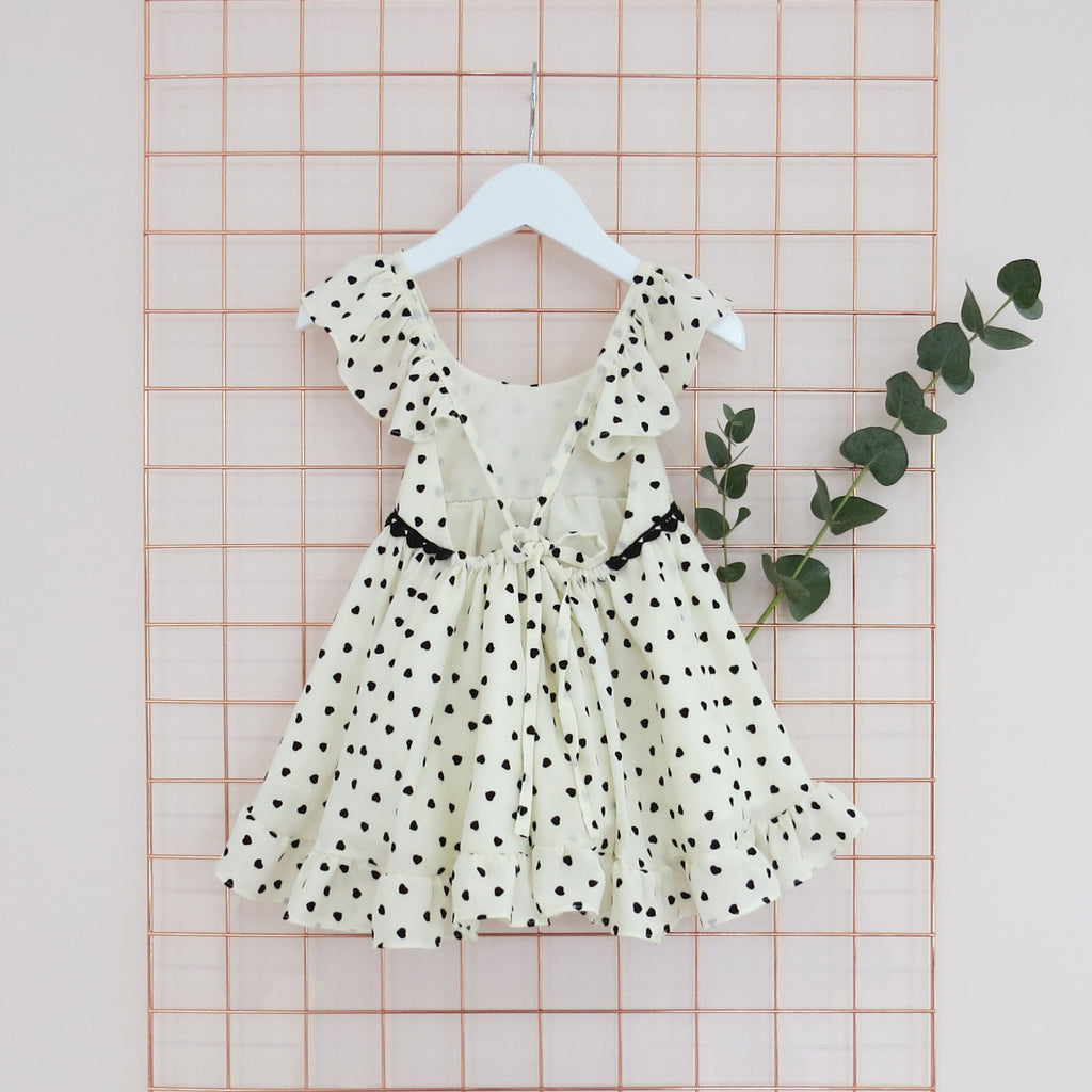 Summer Childs cream and black heart print dress with frill sleeves.