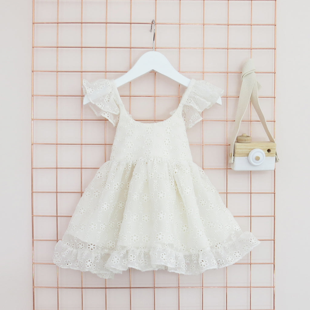 Summer Childs cream silk broderie anglaise dress with frill sleeves.