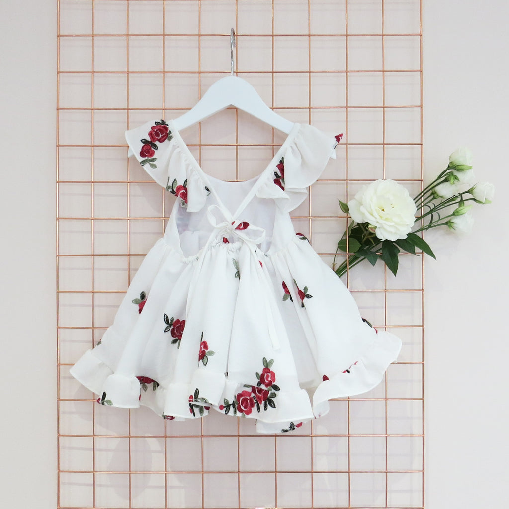 Childs Summer rose embroidery dress on ivory crepe fabric with frill sleeves.