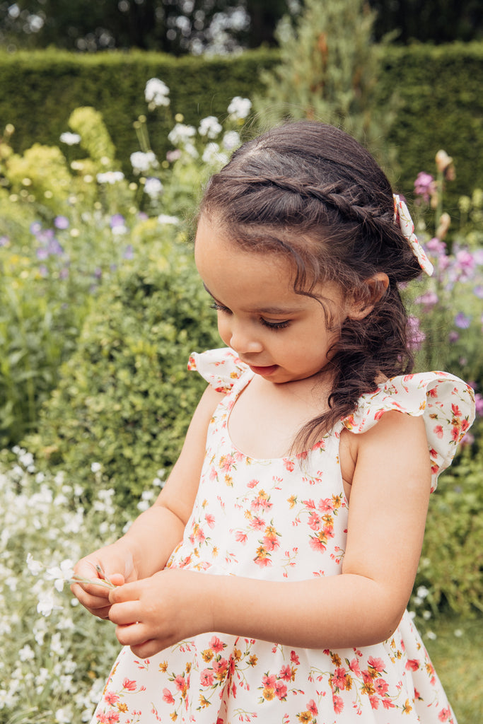 Childs Summer vintage inspired floral ditsy print dress in cream pinks, ochre and sage green with frill sleeves.