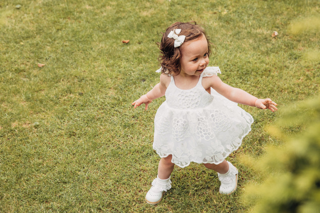 Childs Summer white lace dress with scalloped hem and floral embroidery
