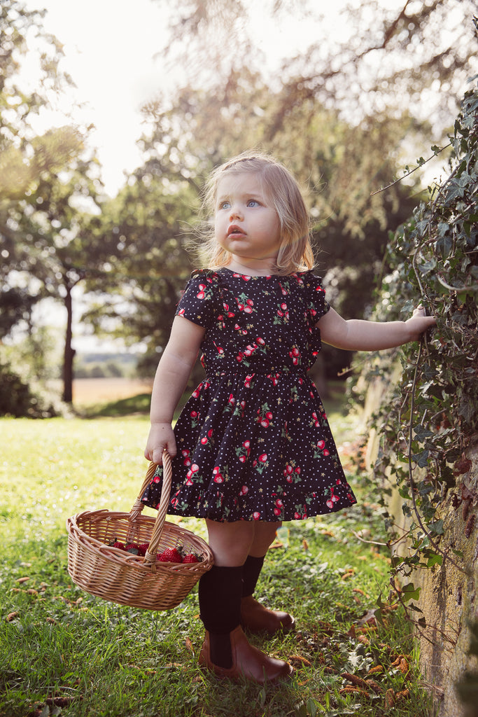 Girls and Childs Autumn Winter strawberry and spot cotton frill dress in black, red and green