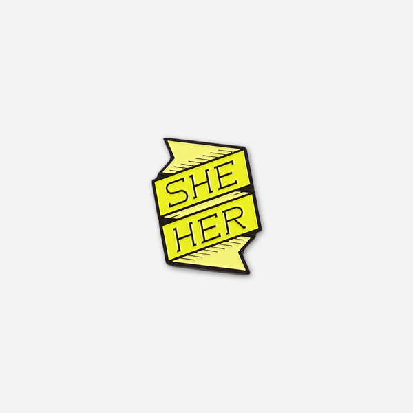 She/Her Pronoun Pin by Autostraddle for sale on hellomerch.com